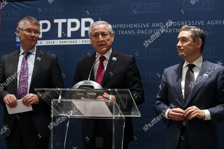 Minister of Foreign Affairs of Chile Heraldo Munoz (C), Canadian Trade Minister François-Philippe Champagne (R) and New Zealand Trade Minister David Parker (L) make a joint statement before signing the Trans-Pacific Partnership (TPP) in Santiago, Chile, 08 March 2018. The TPP comprises Australia, Brunei, Canada, Chile, Malaysia, Mexico, Japan, New Zealand, Peru, Singapore and Vietnam. Unlike the original agreement signed two years ago, the deal does not include the United States as the administration led by President Donald Trump decided to pull out of it.