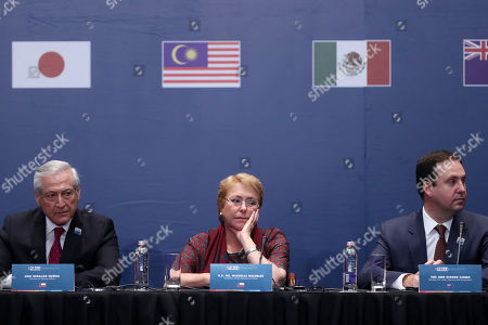 Minister of Foreign Affairs of Chile, Heraldo Munoz (L), the President of Chile, Michelle Bachelet (C), and the Minister of Trade, Tourism and Investment of Australia, Steven Ciobo (R), participate in the signing of the the Trans-Pacific Partnership in Santiago, Chile, 08 March 2018. The TPP comprises Australia, Brunei, Canada, Chile, Malaysia, Mexico, Japan, New Zealand, Peru, Singapore and Vietnam. Unlike the original agreement signed two years ago, the deal does not include the United States as the administration led by President Donald Trump decided to pull out of it.