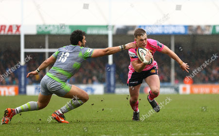 Joe Simmonds of Exeter Chiefs gets past Maxime Mermoz of Newcastle Falcons