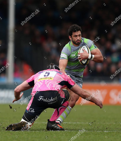 Maxime Mermoz of Newcastle Falcons is tackled by Wilhelm Van Der Sluys of Exeter Chiefs