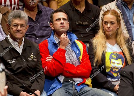 Henry Ramos Allup, Lilian Tintori, Henrique Capriles. Opposition leaders, Henry Ramos Allup, left, Henrique Capriles, center, and Lilian Tintori, wife of jailed leader Leopoldo Lopez attend the opposition's announcement of the creation of a broad front to demand free elections, at a theater in Caracas, Venezuela, . The Venezuelan opposition coalition, allied with various civil organizations, called to revive street actions to protest against the presidential elections on May 20 and pressure the international community not to recognize the Inquiry