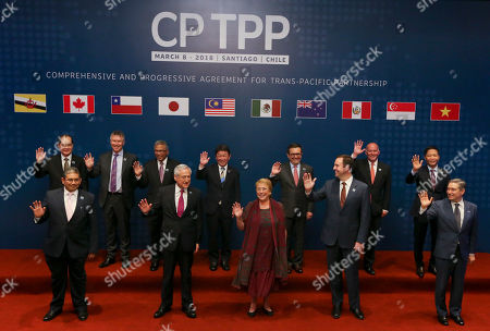 From left front row, Brunei's Foreign Minister Haji Erawan bin Pehin Yusof, Chile's Foreing Minister Heraldo Munoz, Chile's President Michelle Bachelet, Australian Minister for Trade and Investment Steven Ciobo, Canada's Minister of International Trade Francois-Philippe Champagne, and from left back row, Singapore's Minister for Trade and Industry Lim Hng Kiang, New Zealand Trade Minister David Parker, General Secretary Ministry of International Trade and Industry of Malaysia Y.Bhg. Datuk J. Jayasiri, Japan's Trans-Pacific Partnership minister Toshimitsu Motegi, Secretary of Economy of Mexico Idelfonso Guajardo, Peru's Trade Minister Eduardo Ferreyros, Vietnamese Trade Minister Tran Tuan Anh poses for an official photo prior the signing ceremony of the Comprehensive and Progressive Agreement for Trans-Pacific Partnership, CP TPP, in Santiago, Chile