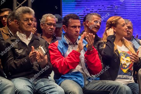 General secretary of Accion Democratica Henry Ramos Allup (L), leader of Primero Justicia and former governor of Miranda state Henrique Capriles (C) and Lilian Tintori (R) participate in an act in Caracas, Venezuela, 08 March 2018. Unhappy chavists, opposition political parties, different religious creeds, students and professional associations and others presented the 'Frente Amplio Venezuela Libre' group which aims to obtain a 'democratic and peaceful' political change in Venezuela.