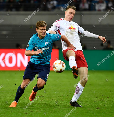 Leipzig's Lukas Klostermann (R) in action against Zenit's Aleksandr Kokorin (L) during the UEFA Europa League round of 16, first leg soccer match between RB Leipzig and Zenit Saint Petersburg in Leipizg, Germany 08 March 2018.