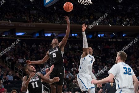 Rodney Bullock, Marcus Foster. Providence forward Rodney Bullock (5) goes to the basket past Creighton guard Marcus Foster (0) during the second half of an NCAA college basketball game in the quarterfinals of the Big East conference tournament, at Madison Square Garden in New York. Providence won 72-68 in overtime