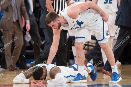 Marcus Foster, Mitch Ballock. Creighton guard Mitch Ballock (24) consoles guard Marcus Foster after Foster missed a jump shot during the final seconds of regulation of an NCAA college basketball game against Providence in the quarterfinals of the Big East conference tournament, at Madison Square Garden in New York