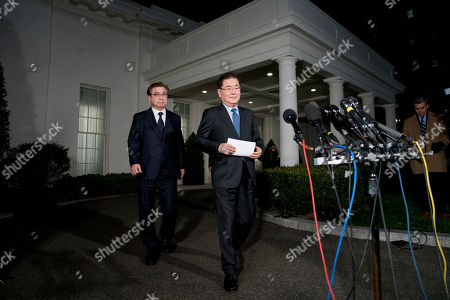 Chung Eui-yong, Suh Hoon. South Korean national security director Chung Eui-yong, center, accompanied by South Korean National Intelligence Service chief Suh Hoon, left, arrives to speak to reporters at the White House in Washington, . President Donald Trump has accepted an offer of a summit from the North Korean leader and will meet with Kim Jong Un by May, a top South Korean official said Thursday, in a remarkable turnaround in relations between two historic adversaries