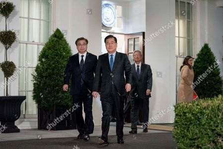 Stock Image of Chung Eui-yong, Suh Hoon. South Korean national security director Chung Eui-yong, center, arrives to speak to reporters at the White House in Washington, with intelligence chief Suh Hoon, left and Cho Yoon-je, the South Korea ambassador to United States. President Donald Trump has accepted an offer of a summit from the North Korean leader and will meet with Kim Jong Un by May, a top South Korean official said in a remarkable turnaround in relations between two historic adversaries