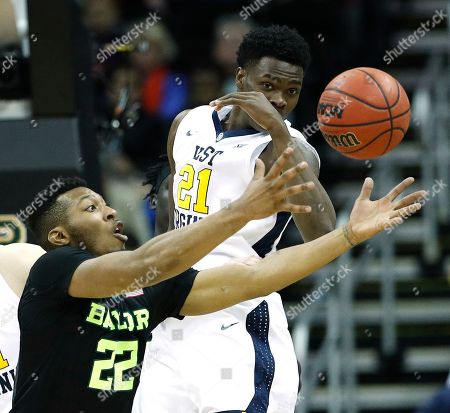 Baylor's King McClure (22) and West Virginia's Wesley Harris (21) chase a rebound during the first half of an NCAA college basketball game in the Big 12 men's tournament, in Kansas City, Mo