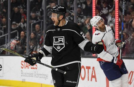Trevor Lewis, Brooks Orpik. Los Angeles Kings center Trevor Lewis, left, celebrates his goal as Washington Capitals defenseman Brooks Orpik skates behind him during the second period of an NHL hockey game, in Los Angeles
