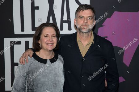 AFS CEO Rebecca Campbell and Paul Thomas Anderson pose on the red carpet