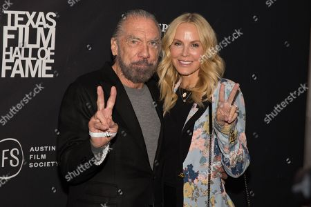 John Paul DeJoria and Eloise Broady pose on the red carpet