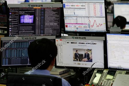 A South Korean dealer works in front of monitors at the KEB Hana Bank in Seoul, South Korea, 09 March 2018.   The benchmark South Korea Composite Stock Price Index (KOSPI) rose 26.37 points to 2,459.45, after the 09 March 2018 announcemnt that North Korean leader Kim Jung-un and US president Donald J. Trump will meet in May.