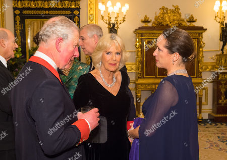 Prince Charles and Camilla Duchess of Cornwall (centre) with Princess Zahra Aga Khan in the White Drawing Room at Windsor Castle during a reception before a private dinner to mark the diamond jubilee of the Aga Khan's leadership as Imam of the Shia Ismaili Muslim Community