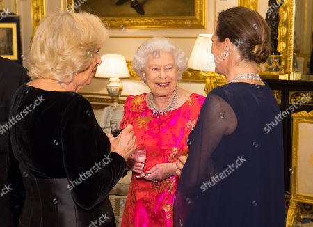 Stock Photo of Queen Elizabeth II with Camilla Duchess of Cornwall (left) and Princess Zahra Aga Khan in the White Drawing Room at Windsor Castle during a reception before a private dinner to mark the diamond jubilee of the Aga Khan's leadership as Imam of the Shia Ismaili Muslim Community