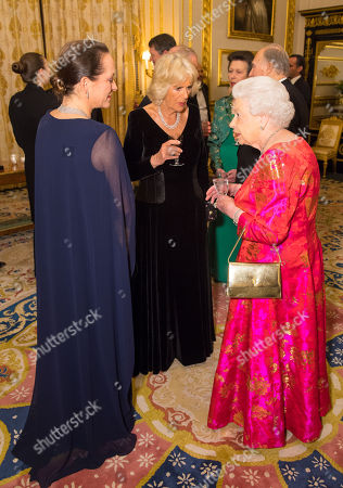 Stock Photo of Queen Elizabeth II with Camilla Duchess of Cornwall (centre) and Princess Zahra Aga Khan (left) in the White Drawing Room at Windsor Castle during a reception before a private dinner to mark the diamond jubilee of the Aga Khan's leadership as Imam of the Shia Ismaili Muslim Community