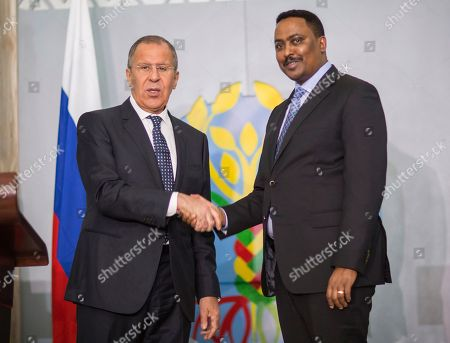 Russian Foreign Minister, Sergey Lavrov, left, shakes hands with Ethiopian Foreign Minister Workneh Gebeyehu, in Addis Ababa Ethiopia, . Ethiopia and Russia agree to establish a nuclear technology centre to work on nuclear projects for peaceful purposes in Ethiopia