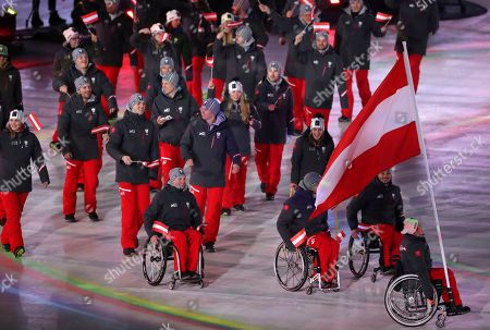 Stock Picture of Claudia Loesch carries the flag of Austria as she leads her delegation into the opening ceremony of the 2018 Winter Paralympics in Pyeongchang, South Korea