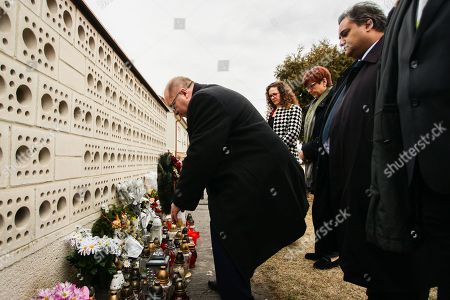 Members of the European Parliament (MEP) Sophie in 't Veld (2-L), Ingeborg Grässle (2-R), Claude Moraes (R) and the Mayor of Velka Maca Stefan Lancz (L) pay their respects to the murdered journalist Jan Kuciak and his fiancee Martina Kusnirova in Velka Maca, Slovakia, 09 March 2018. The delegation of MEP's are visiting Slovakia for a two-day fact-finding mission following the murder of investigative journalist Jan Kuciak and his fiancee.