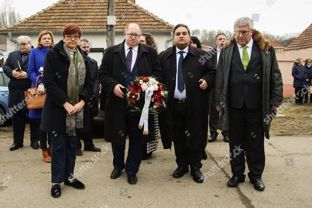 Members of the European Parliament (MEP) Ingeborg Graessle (L), Claude Moraes (2-R),  Ryszard Czarnecki (R) and the Mayor of Velka Maca Stefan Lancz (2-L) pay their respects to the murdered journalist Jan Kuciak and his fiancee Martina Kusnirova in Velka Maca, Slovakia, 09 March 2018. The delegation of MEP's are visiting Slovakia for a two-day fact-finding mission following the murder of investigative journalist Jan Kuciak and his fiancee.