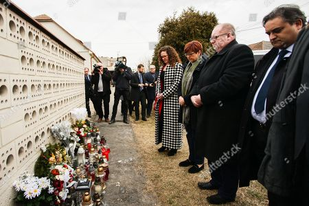 Members of the European Parliament (MEP) Claude Moraes (R), Ingeborg Graessle (2-L), Sophie in 't Veld (L) and the Mayor of Velka Maca Stefan Lancz (2-R) pay their respects to the murdered journalist Jan Kuciak and his fiancee Martina Kusnirova in Velka Maca, Slovakia, 09 March 2018. The delegation of MEP's are visiting Slovakia for a two-day fact-finding mission following the murder of investigative journalist Jan Kuciak and his fiancee.