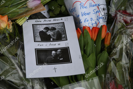 People pay respect to Prince Henrik with flowers, messages and photographs of Queen Margrethe and Prince Henrik together