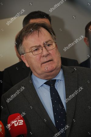 Denmark's minister for defence Claus Hjort Frederiksen appears at a local press conference