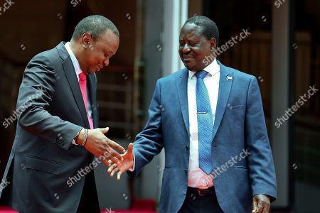 Uhuru Kenyatta, Raila Odinga. Kenya's President Uhuru Kenyatta, left, shakes hands with opposition leader Raila Odinga, right, outside Harambee House in Nairobi, Kenya . Kenya's president and opposition leader announced Friday they will work together to unite the country, which has been divided along ethnic lines following last year's disputed elections
