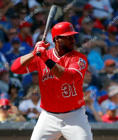 Los Angeles Angels' Chris Carter hits against the Chicago Cubs during the first inning of a spring training baseball game, in Mesa, Ariz