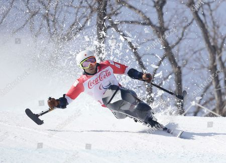 Akira Kano of Japan competes in the men's downhill, sitting, at the 2018 Winter Paralympics in Jeongseon, South Korea