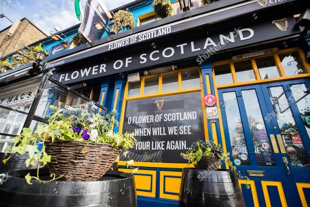 Stock Photo of As revealed by Gavin Hastings on Wednesday and to celebrate the camaraderie between rugby fans, today Guinness has renamed well-known Dublin pub Paddy Cullen?s to the ?Flower of Scotland? ahead of Ireland?s NatWest Six Nations clash with Scotland. The bespoke destination has been created for a pre-match pint for both Irish and Scottish fans alike, welcoming all fans, whatever their jersey! . A special collaboration of Irish pipers and drummers ?The Guinness Rugby Collective? will play some of the best loved rugby anthems including ?Flower of Scotland? and ?Molly Malone? to build the match day atmosphere ahead of kick-off at 14:15. #GuinnessRugby #MadeofMore
