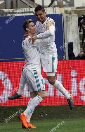 Real Madrid's Portuguese striker Cristiano Ronaldo (L) celebrates with Carlos Henrique Casimiro (R) after scoring the opening goal against SD Eibar during the Spanish Liga Primera division soccer match played at Ipurua stadium, in Eibar, northern Spain, 10 March 2018.