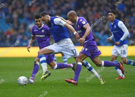 Atdhe Nuhiu of Sheffield Wednesday and Karl Henry of Bolton Wanderers