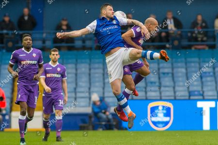 Arial battle for the ball between Sheffield Wednesday Midfielder Daniel Pudil & Bolton Wanderers midfielder Karl Henry (24) during the EFL Sky Bet Championship match between Sheffield Wednesday and Bolton Wanderers at Hillsborough, Sheffield. Picture by Craig Zadoroznyj
