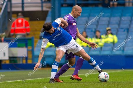 Sheffield Wednesday Midfielder George Boyd battles with Bolton Wanderers midfielder Karl Henry (24) during the EFL Sky Bet Championship match between Sheffield Wednesday and Bolton Wanderers at Hillsborough, Sheffield. Picture by Craig Zadoroznyj
