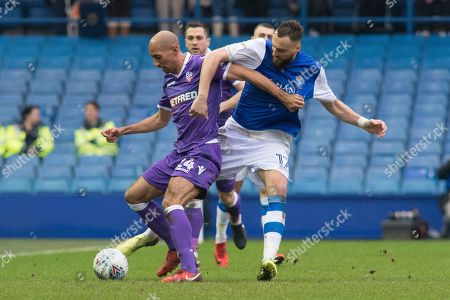 Sheffield Wednesday Forward Atdhe Nuhiu battles with Bolton Wanderers midfielder Karl Henry (24) during the EFL Sky Bet Championship match between Sheffield Wednesday and Bolton Wanderers at Hillsborough, Sheffield. Picture by Craig Zadoroznyj