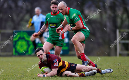 Stock Image of Sam Baker of Ampthill beats Matt Crosscombe of Plymouth Albion to the ball during the National Division 1 match between Ampthill v Plymouth Albion at Dillingham Park, Ampthill, Bedfordshire on March 10th 2018, UK.