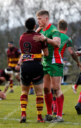 Sam Daly of Plymouth Albion helps Kevin Barret of Ampthill to his feet after Ampthill conceded a try during the National Division 1 match between Ampthill v Plymouth Albion at Dillingham Park, Ampthill, Bedfordshire on March 10th 2018, UK.