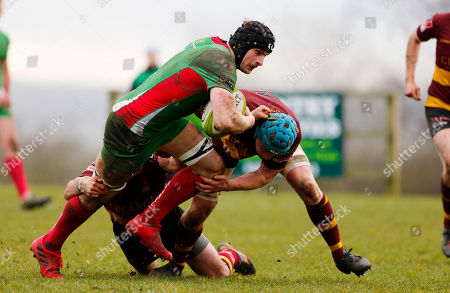 George Mills of Plymouth Albion is tackled by Kevin Barret of Ampthill and Joe Bercis of Ampthill during the National Division 1 match between Ampthill v Plymouth Albion at Dillingham Park, Ampthill, Bedfordshire on March 10th 2018, UK.