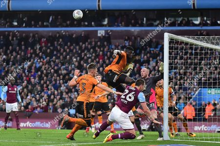 Wolverhampton Wanderers midfielder (on loan from Villarreal) Alfred N'Diaye (4) jumps highest and heads clear during the EFL Sky Bet Championship match between Aston Villa and Wolverhampton Wanderers at Villa Park, Birmingham. Picture by Dennis Goodwin