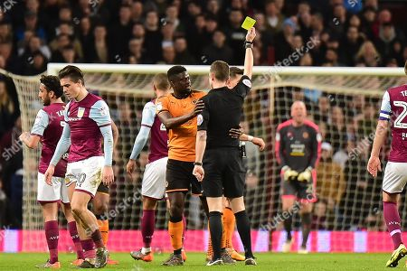 Wolverhampton Wanderers midfielder (on loan from Villarreal) Alfred N'Diaye (4) shown a yellow card,booked  during the EFL Sky Bet Championship match between Aston Villa and Wolverhampton Wanderers at Villa Park, Birmingham. Picture by Dennis Goodwin