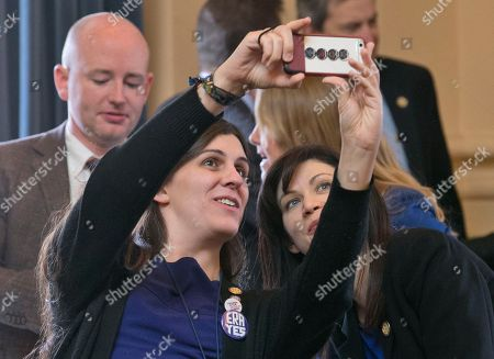 Danica Roem, Karrie Delaney. Virginia Del. Danica Roem, D-Prince William takes a selfie with Del. Karrie Delaney, D-Fairfax, at the end of the 2018 session of the Virginia General Assembly at the Capitol in Richmond, Va