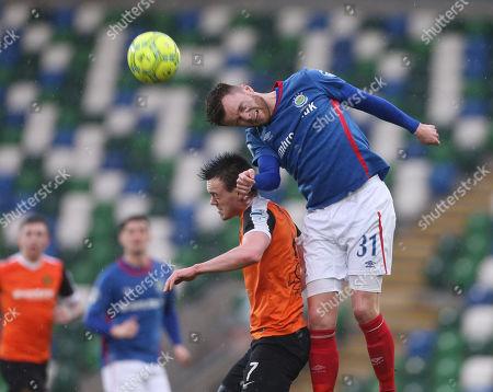 Linfield vs Carrick Rangers. Linfield's Niall Quinn with Carrick's Lee Chapman