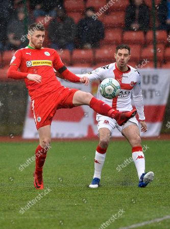 Cliftonville vs Crusaders. Cliftonville's Rory Donnelly in action with Crusaders Sean Ward