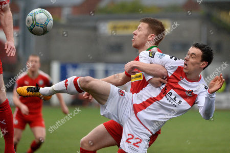 Cliftonville vs Crusaders. Cliftonville's Stephen Garrett in action with Crusaders Paul Heatley