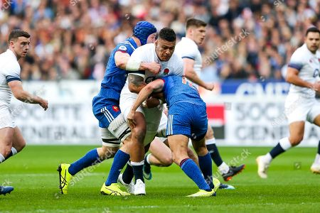Stock Image of Nathan Hughes of England is tackled by Wenceslas Lauret and Geoffrey Doumayrou of France