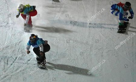 Stock Photo of First place winner Eva Samkova (2nd-L) of Czech Republic, second place winner Nelly Moenne Loccoz (L) of France and Michela Moioli (R) of Italy finish at the big final of the Ladies Snowboard Cross race at the FIS Snowboard World Cup 2018 in Moscow, Russia, 10 March 2018.