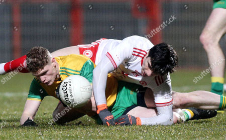 Tyrone vs Donegal. Tyrone's Lee Brennan and Donegal's Conor Morrison