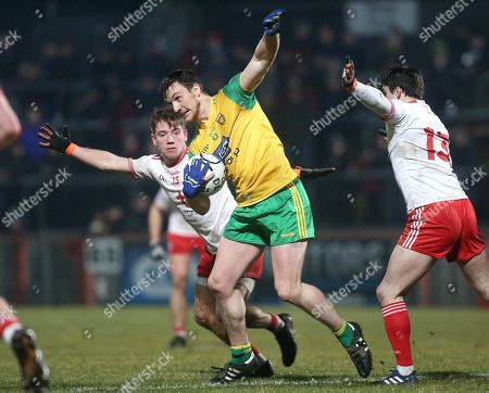 Tyrone vs Donegal. Donegal's Leo McLoone with Tyrone's Mark Bradley and Lee Brennan