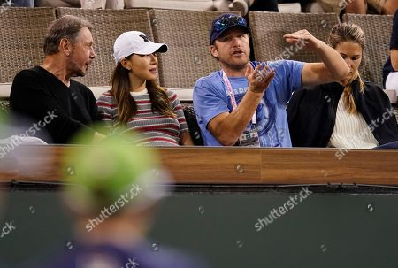 Former USA Alpine skier Bode Miller (2-R) talks with Larry Ellison, co-founder, Executive Chairman of Oracle Corporation  (L) during the BNP Paribas Open at the Indian Wells  Tennis Garden in Indian Wells, California, USA,10  March 2018.
